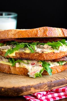NYT Cooking: This update on a workaday sandwich takes time and work, it's true. But the result, Julia Reed says, is the best old-fashioned tuna salad sandwich you've ever had in your life. You'll need one pound of yellowfin tuna, which you'll poach with aromatics, cool and then mix with a few chopped peppers, fennel seed, onion and herbs. If you plan ahead, you can make the tun...