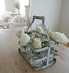 love this idea to put vases in the bottle holder and one flower per vase.