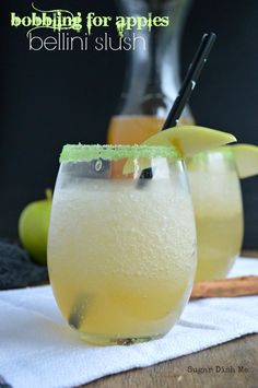 """Bobbing for Apples Bellini Slush - Sugar Dish Me  For the Apples: -1 firm, tart apple, chopped into 1"""" pieces -½ cup (4 ounces) apple pie vodka For the Bellini Slush: -4 cups ice -6 ounces apple pie vodka -1 cup spiced apple cider -1 750 mL bottle of #Delamotte Champagne -rimming sugar and more apple slices to garnish"""
