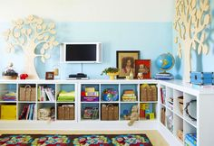 Perfect playroom idea minus the television set. Love the shelves placed against the walls.