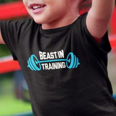 """The world will know how tough you and your kids are when they sport these new """"Beast In Training"""" Kids T-shirts. They match your """"World's Strongest Dad"""" T-Shirt perfectly. Everyone will know not to mess with this team. You can buy your kids these short sleeve t-shirts, and you can also get your baby a """"Beast in Training"""" Onesie! You will be one intimidating crew when you all walk into the the CrossFit gym together. Use coupon code PINFIVE for 5% off! #giftideasfinder #fitmom #beastintraining"""
