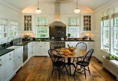 Farmhouse kitchen - love the windsor chairs!