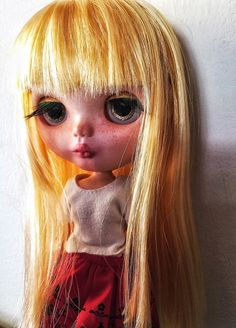 Blythe doll - https://www.etsy.com/it/listing/234597909/irina-custom-blythe-doll-cousin-olivia