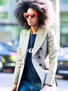 Double breasted blazer paired with a tee shirt and red statement cat-eye sunglasses