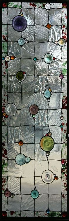 Leadlight: This Nugget window graces a contemporary house in Swampscott, MA. The house is set on a stunning lot above ocean facing cliffs. The window is installed in a door to a four season porch and, although it is based on Gothic design principles, blends with the contemporary architecture and stunning collection of art glass.