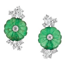 Pair of Platinum, Carved Emerald and Diamond Earclips, Chaumet 18 kt., centering 2 fluted domed emeralds surmounted by 2 round diamonds, flanked by clusters of 4 marquise-shaped and 18 round diamonds, total approximately 1.70 cts.