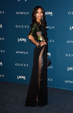 Zoe Saldana.. Gucci Fall 2013 and Spring 2014 hybrid frock, featuring sheer, black and lime-green body contouring panels..