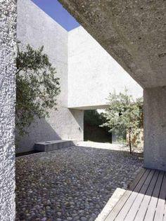 "neubau haus ri. in brissago ti  2013 The ""village"" square with beautiful olive trees."
