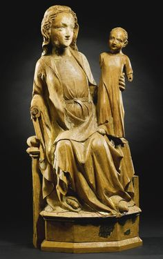 GERMAN, COLOGNE, CIRCA 1335-1340 VIRGIN AND CHILD ENTHRONED walnut, with remnants of original polychromy, on a later wood base group: 61 by 28cm., 24 by 11in. base: 2cm., ¾in.