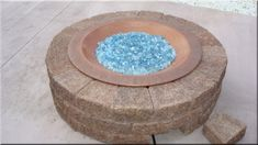 gas fire pit with glass... add it to brandon's DIY list!