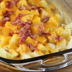 "Ranch Potatoes - 8-10 medium potatoes (cut into ½"" cubes)  1 can cream of mushroom soup (undiluted)  1 ½ cups milk  1 envelope ranch dressing mix  2 cups shredded cheddar cheese (divided)  salt and pepper  6  bacon slices (cooked until crispy and crumbled)"