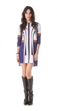 LOTUS TEMPLE SHIFT DRESS $231.62 SPECIAL $75.60 YOU SAVE: 67% Exclusive to DressyCart.  This cheerful, patterned Clover Canyon shift dress falls to a split, uneven hem, and a button keyhole fastens behind the neck. Long sleeves. Unlined.