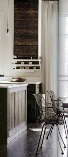 Love the look of repurposed wood... especially in a modern kitchen  wood and wireElle Decor - Photograph by William Waldron