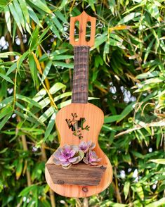 I'm loving this handmade ukulele planter for a plant wall or a gallery wall which is where I have mine 🌺 succulents are happy! Wooden Containers, Succulents In Containers, Pineapple Ukulele, Dish Garden, Wood Planters, Succulent Arrangements, Plant Wall, Air Plants, Cacti
