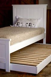 Solid wood children's 'Trundler Bed' made from NZ pine on easy roll castors