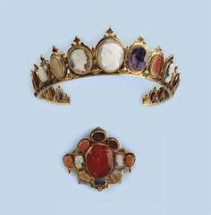 Circa 1860 Diadem designed in a line of graduated cameos carved in various hardstones, amethyst, carnelian, and agates set within a red and blue enameled mount; matching brooch set with various hardstone cameos; via Christies.