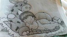 Bebê com girafa