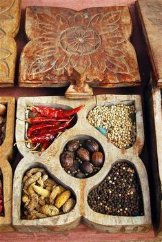 Indian spice box...I have a couple different ones...one similar to this, and a hammered metal one