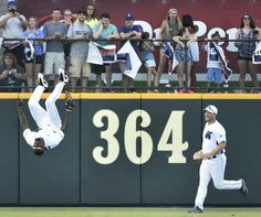 Dallas Cowboys NFL football receiver Dez Bryant does a flip in front of the crowd and former MLB pitcher Mike Bascik, right, after he made a catch for an out during the Dirk Nowitzki Heroes Celebrity Baseball Game at Dr. Pepper Ballpark in Frisco, Texas on Saturday, June 27, 2015. Michael Ainsworth/The Dallas Morning News)