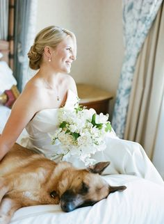 Portrait of bride sitting at the Fairmont Hotel in San Francisco with her german shepherd dog., gorgeous whites + greens bouquet, shot by Sylvie Gil