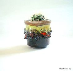 Small planter / cactus planter by Glit Lava Iceland , lava decorated and glazed in brown with lime green and orange. by Cherryforest on Etsy