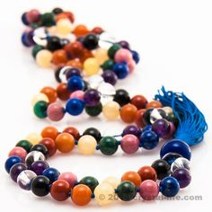 I designed this chakra mala back in 1995 because I wanted something to help stabilize my energy throughout the day - I was living in New York City and working at the United Nations at that time. Heavy duty energy going on! This mala has a special ceramic catalyst bead in the meru (guide bead) position - it keeps the beads clear and helps strengthen and stabilize the body's chakra energy even more. This is a workhorse combination for gemstone therapy lovers!