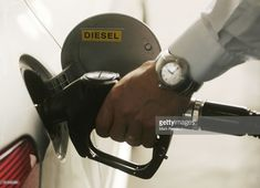 A driver fills up the tank of his car with diesel at a fuel station on May 29, 2008 in Luxembourg city. Customers are driving up to 100 km from neighbouring countries Belgium, France and Germany to fill up their vehicles with fuel, which is much cheaper in Luxembourg due to lower taxes. (Photo by Mark Renders/Getty Images)