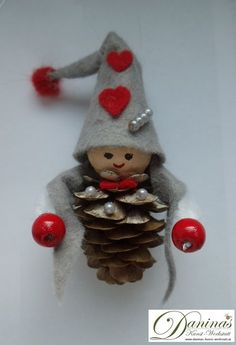 The handmade figure made of natural material is ideal as a gift, as a Christmas decora Christmas Pine Cones, Gold Christmas, Diy Christmas Ornaments, Kids Christmas, Handmade Christmas, Christmas Tree Decorations, Xmas, Simple Christmas, Holiday Crafts For Kids
