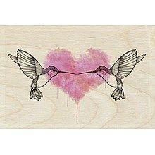 Twee verliefde vogeltjes op hout als muurdecoratie voor de kinderkamer.