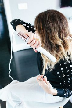 Blogger Lindsey Lutz from Life Lutzurious wearing a black studded Topshop top and straightening hair with the t3 Micro