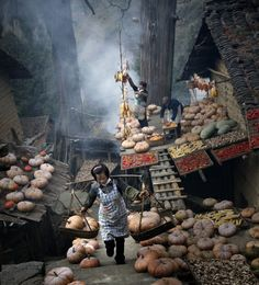 Taken in a small village in southeast of china called Lishui. People are busy gathering and picking the pumpkin to the market. - NATIONAL GEOGRAPHIC