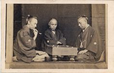 "Samurai playing a game of ""go""."