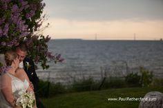 Mackinac bridge and Mackinac lilacs with bride groom on Mackinac Island, Michigan wedding photography by Paul Retherford #MackinacIsland #Lilac #MackinacBridge