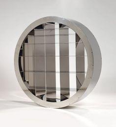 """ARAD RON (1951)  """"RTW,"""" 1996 Bibliothèque circulaire à bâti et étagères en lames d'acier chromé, rayonnages montés sur roulements à billes. Signée, numérotée 16/20. Diamètre : 130 cm Bibliographie : Modèle similaire reproduit dans : - Antonelli Paola, """"Ron Arad No Discipline"""", Museum of Modern Art, New York 2009, page 21 (version aluminium) page 129 (version acier). - Camard & Associés - 01/12/2010"""