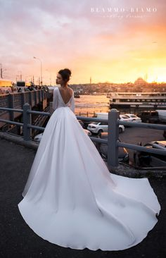 Wedding dress Tilda by Blammo-Biamo. Bateau neckline long sleeves open back ball gown simple elegant royal satin wedding dress. Ship worldwide. Based in Vancouver, Canada.