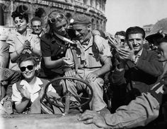 Roman citizens give a hero's welcome to a British soldier of the Allied Fifth army, which captured Rome some 12 days after seizing the Anzio beachhead in May 1944. As the Allies pressed from the south, German forces were forced into a rapid retreat, and Rome was spared a prolonged siege and street-to-street fighting.