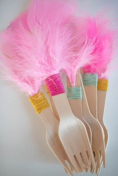Feather embellished wood cutlery from Flamingo + Flamingle Pineapple Party at Kara's Party Ideas. See more at karaspartyideas.com!