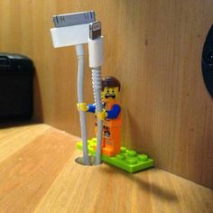 Turns out Lego people have the perfect size hands for phone charges. Up cycle unused Lego pieces.