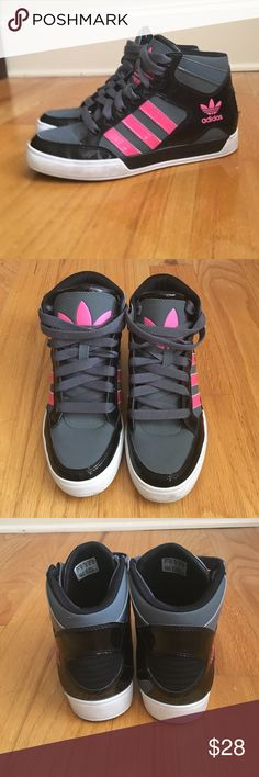 Adidas High Top Sneakers Girl's Adidas High Top Sneakers.  In great condition.  Color: Dark Gray, Black and Pink.  Gray Laces. Some scuffing on white part of soles.  My daughter wore for a hip hop dance class but outgrew quickly.  Very little street wear, pretty much for dance classes inside. adidas Shoes Sneakers