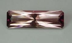 Tourmaline, Md Silver Pink, 8.60 cts long emerald brilliant cut measuring 23.3x7.3x6.4 mm, eye clean, from Nigeria.
