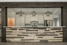 Kitchen island created using BrewPub in Blonde Ale and Midnight Ale by Great American Spaces