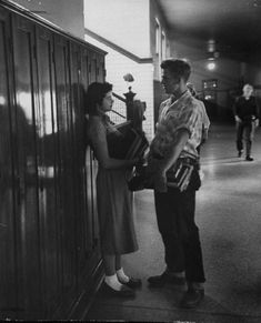 A boy and a girl in the hallway of Davenport High School, Iowa, 1953