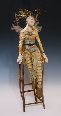 Anika Blout positioned many of her amazing Art Dolls on hand-wrought chairs. c 2006
