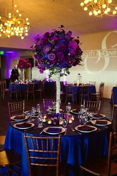 Purple And Blue Wedding Color Theme Linens With Centerpieces Of Flowers Dark Brown Chiavari Chairs