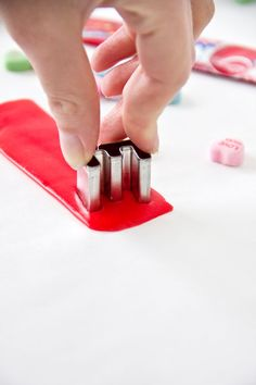 Use Airheads candy to cut out letters for birthday cakes