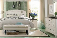 beach house bedroom idea.  Love the glass jars for deco. :-) and the picture frames hanging from ribbon. :-)