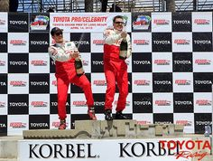 2012 Toyota Pro/Celebrity Race winners Adam Carolla and Fredric Aasbo celebrate in victory circle. #TPCR