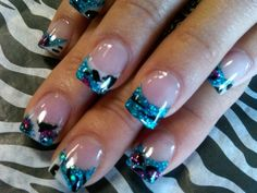 Nails....Lions and tigers and bears.... These nails were created with acrylic and paint. Glitter acrylic was done first. Next I used acrylic paint to create the animal print. Once the paint was dry I caped the tip with clear acrylic.