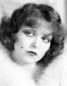 Clara Bow photographed by Eugene Robert Richee, 1929. Note the heart shaped beauty mark.