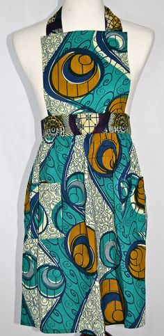 Gahaya Links Full 50's Style Apron. This 1950's retro full-style apron will make a big splash in your kitchen with it's bold African print. Woven cotton, washable. Will keep you clean and show off your good taste.